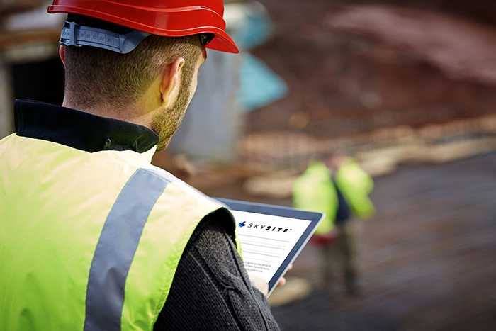 A Construction Professional Working With SKYSITE Construction Management App