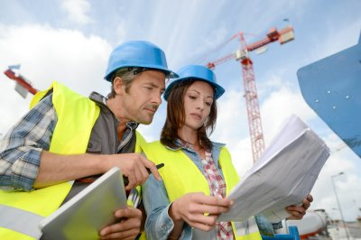 A Women Construction Worker Working With Construction Engineer